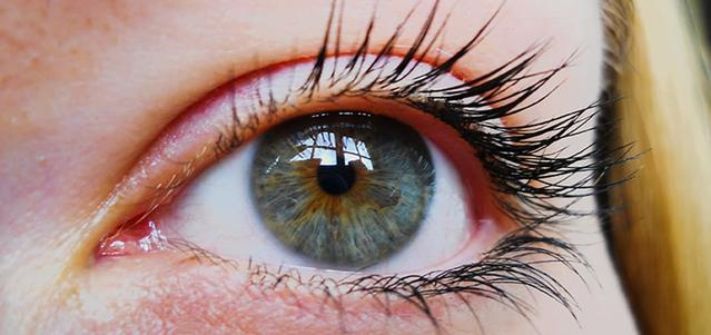 Close up image of a woman's green/blue eye